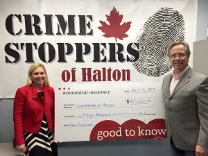 Doug Maybee from Economical Insurance presenting generous sponsorship cheque to former Crime Stoppers Chair Jennifer Olchowy