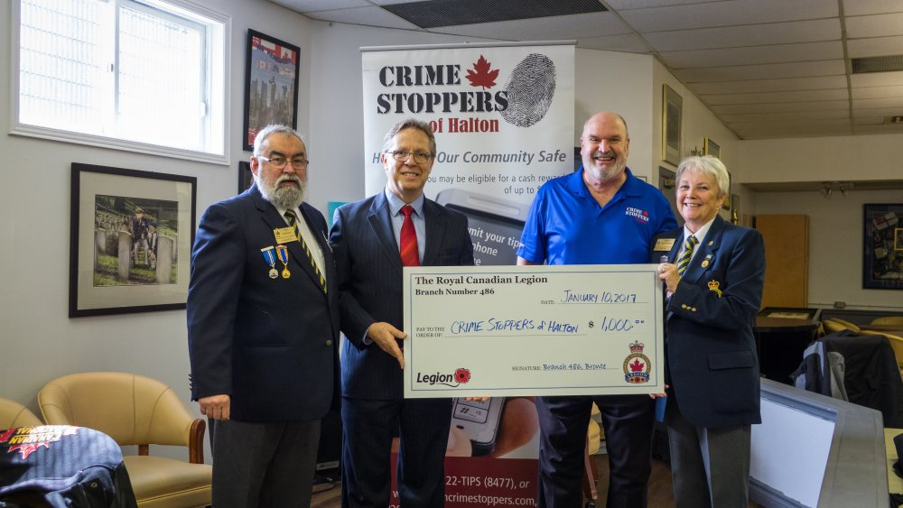 (From Left) RCL Branch 486 President Fred Norman, Crime Stoppers of Halton Chair Doug Maybee, Crime Stoppers of Halton Board Member Wally Trapler, RCL Branch 486 2nd Vice Mary Nieuwpoort